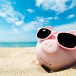 Piggy Bank Wearing Sunglasses Relaxing At The Beach